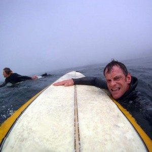 Jim Simpson surfing the Washington Coast.